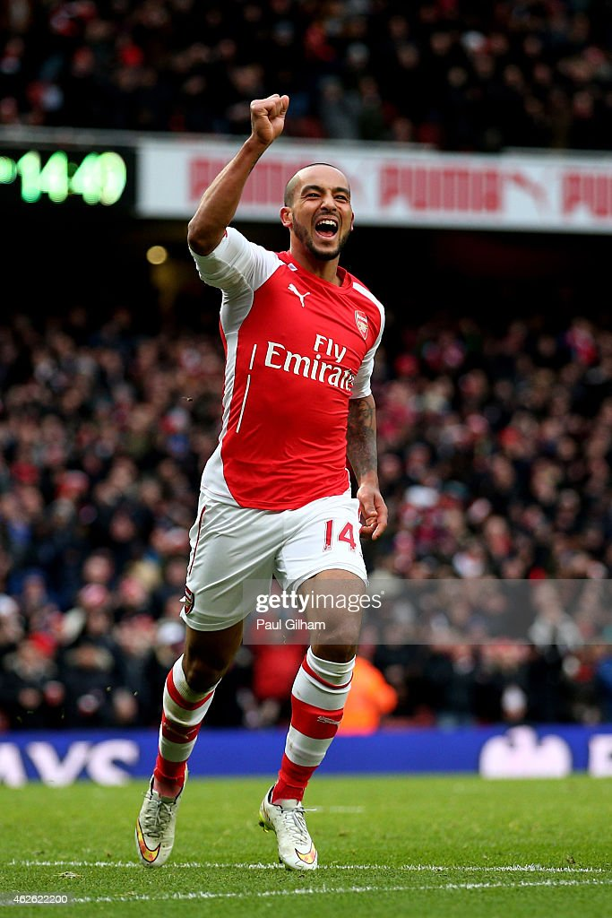 <a gi-track='captionPersonalityLinkClicked' href=/galleries/search?phrase=Theo+Walcott&family=editorial&specificpeople=451535 ng-click='$event.stopPropagation()'>Theo Walcott</a> of Arsenal celebrates after scoring his team's third goal during the Barclays Premier League match between Arsenal and Aston Villa at the Emirates Stadium on February 1, 2015 in London, England.
