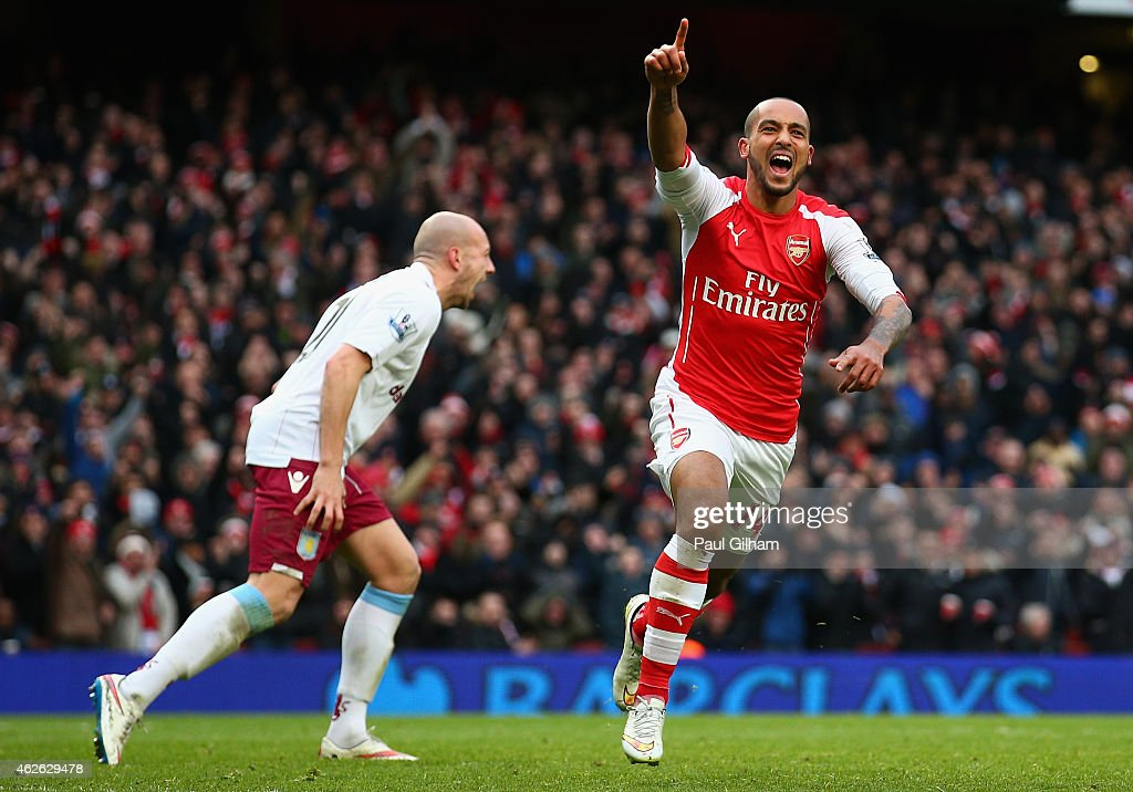 Theo Walcott of Arsenal celebrates after scoring his team's third goal during the Barclays Premier League match between Arsenal and Aston Villa at the Emirates Stadium on February 1, 2015 in London, England.