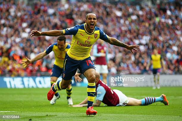 Theo Walcott of Arsenal celebrates as he scores their first goal during the FA Cup Final between Aston Villa and Arsenal at Wembley Stadium on May 30...
