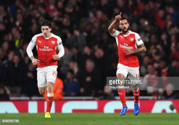 Theo Walcott of Arsenal celebrates as he scores their first goal with Hector Bellerin during the UEFA Champions League Round of 16 second leg match...