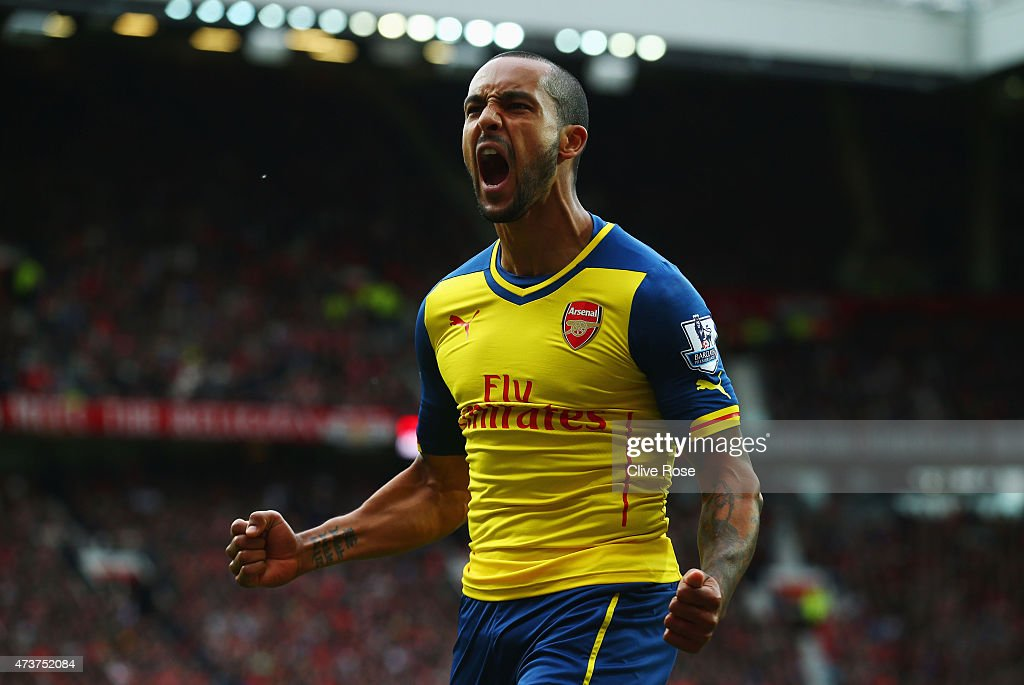 <a gi-track='captionPersonalityLinkClicked' href=/galleries/search?phrase=Theo+Walcott&family=editorial&specificpeople=451535 ng-click='$event.stopPropagation()'>Theo Walcott</a> of Arsenal celebrates as his cross deflects of off Tyler Blackett of Manchester United for an own goal during the Barclays Premier League match between Manchester United and Arsenal at Old Trafford on May 17, 2015 in Manchester, England.