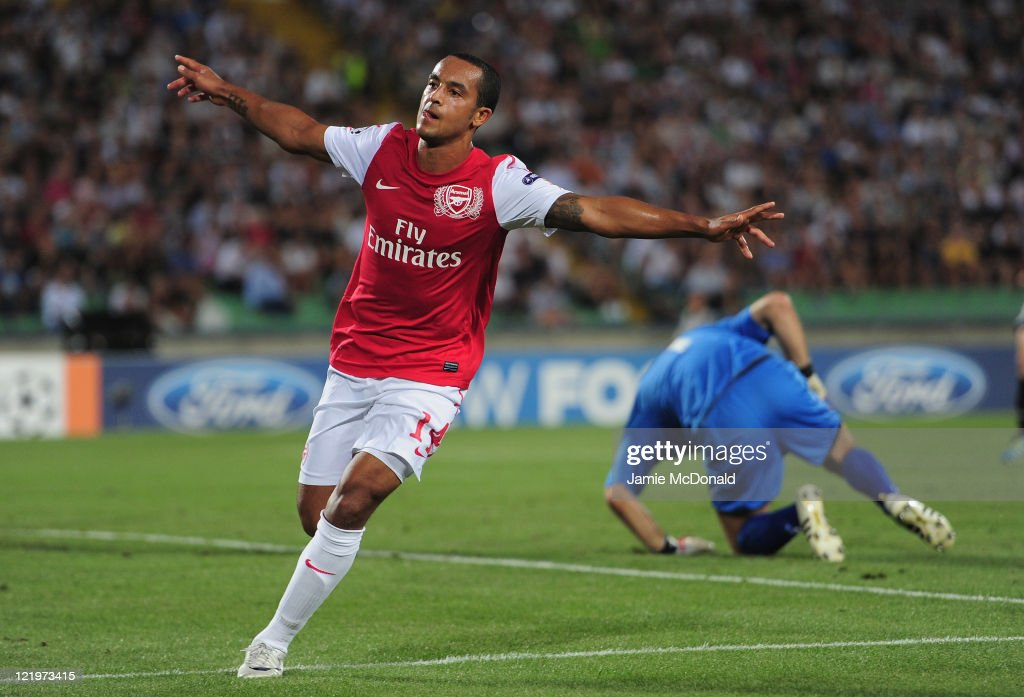 Theo Walcott of Arsenal celebrates his goal during the UEFA Champions League playoff second leg match between Udinese Calcio and Arsenal FC at the...