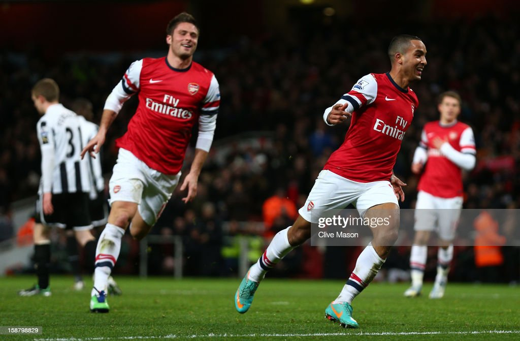 Theo Walcott of Arsenal celebrates scoring his hat trick and Arsenal's seventh goal with Olivier Giroud of Arsenal during the Barclays Premier League match between Arsenal and Newcastle United at the Emirates Stadium on December 29, 2012 in London, England.