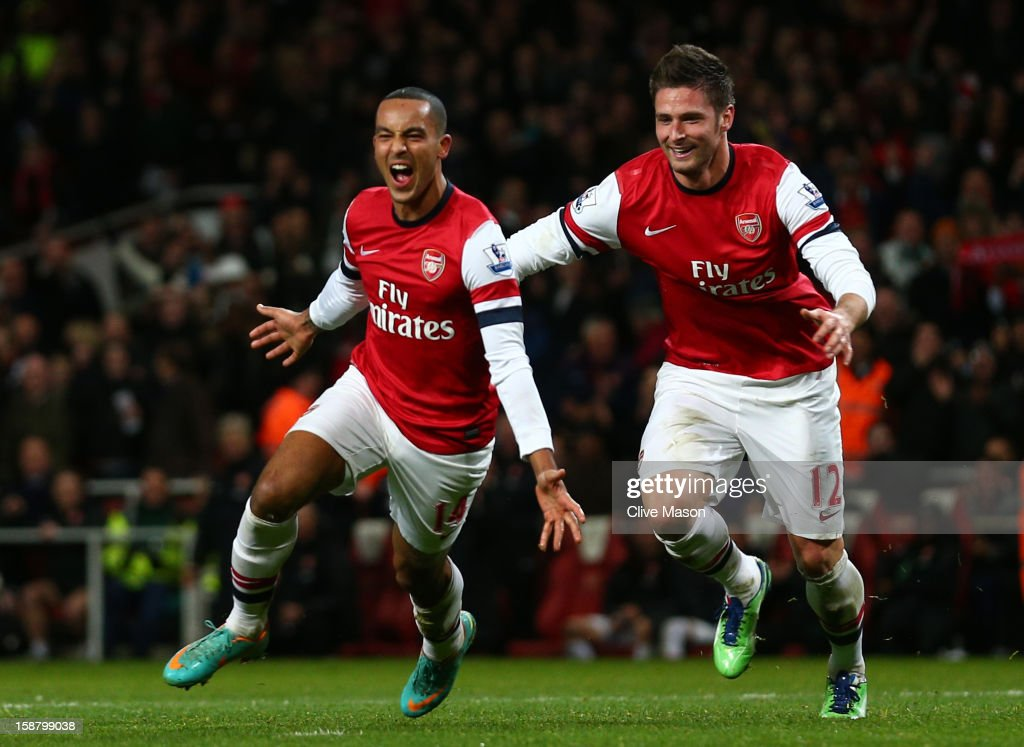 <a gi-track='captionPersonalityLinkClicked' href=/galleries/search?phrase=Theo+Walcott&family=editorial&specificpeople=451535 ng-click='$event.stopPropagation()'>Theo Walcott</a> of Arsenal celebrates scoring his hat trick and Arsenal's seventh goal with <a gi-track='captionPersonalityLinkClicked' href=/galleries/search?phrase=Olivier+Giroud&family=editorial&specificpeople=5678034 ng-click='$event.stopPropagation()'>Olivier Giroud</a> of Arsenal during the Barclays Premier League match between Arsenal and Newcastle United at the Emirates Stadium on December 29, 2012 in London, England.