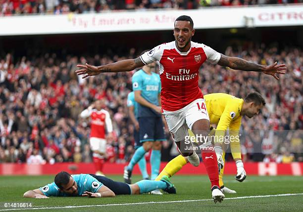 Theo Walcott of Arsenal celebrates scoring his sides first goal during the Premier League match between Arsenal and Swansea City at Emirates Stadium...