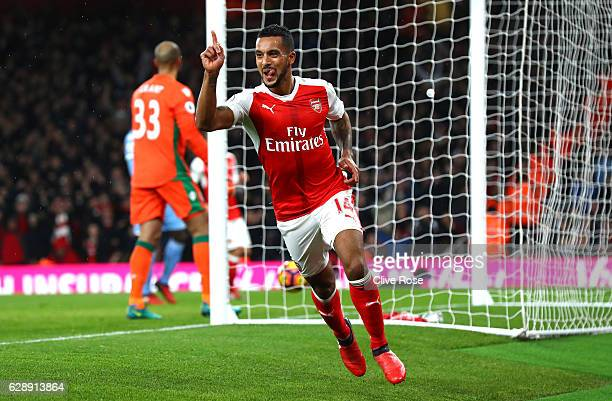 Theo Walcott of Arsenal celebrates scoring his sides first goal during the Premier League match between Arsenal and Stoke City at the Emirates...