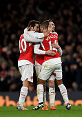 Theo Walcott of Arsenal celebrates scoring his side's first goal with Mathieu Flamini of Arsenal and Aaron Ramsey of Arsenal during the Barclays...