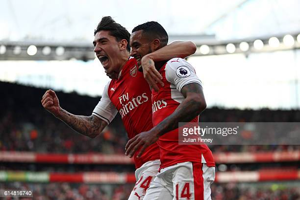 Theo Walcott of Arsenal celebrates scoring his sides first goal with team mate Hector Bellerin of Arsenal during the Premier League match between...