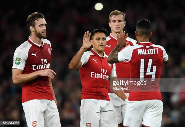 Theo Walcott of Arsenal celebrates scoring his sides first goal with his Arsenal team mates during the Carabao Cup Third Round match between Arsenal...