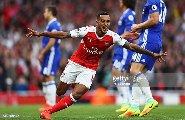 Theo Walcott of Arsenal celebrates scoring his sides second goal during the Premier League match between Arsenal and Chelsea at the Emirates Stadium...