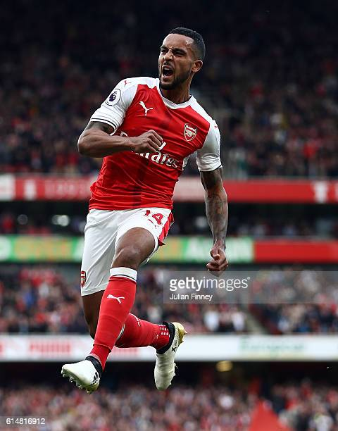 Theo Walcott of Arsenal celebrates scoring his sides second goal during the Premier League match between Arsenal and Swansea City at Emirates Stadium...