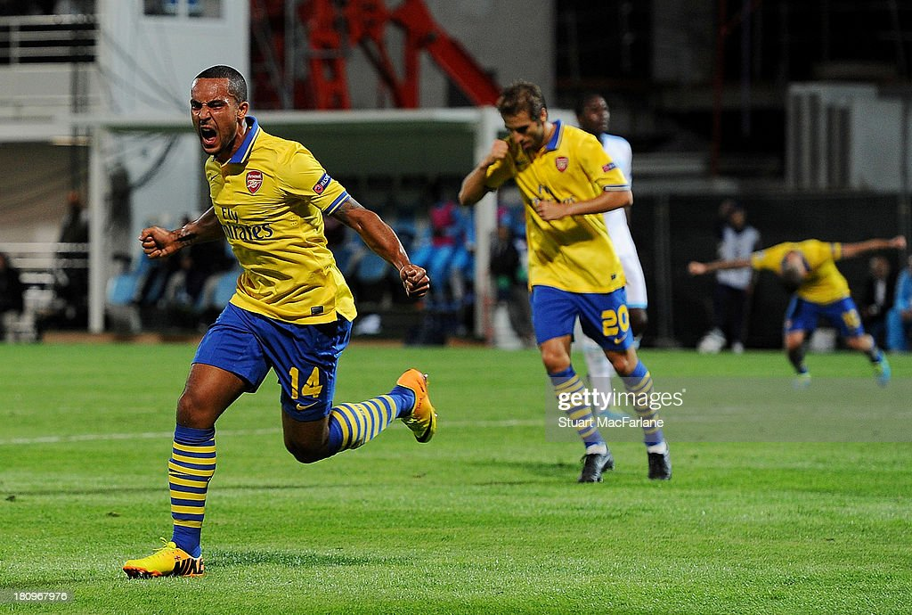 <a gi-track='captionPersonalityLinkClicked' href=/galleries/search?phrase=Theo+Walcott&family=editorial&specificpeople=451535 ng-click='$event.stopPropagation()'>Theo Walcott</a> of Arsenal celebrates scoring his team's first goal during the UEFA Champions League match between Olympique de Marseille and Arsenal at Stade Velodrome on September 18, 2013 in Marseille, France.
