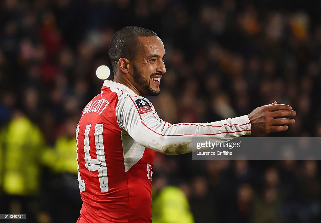 Theo Walcott of Arsenal celebrates scoring his team's fourth goal during the Emirates FA Cup Fifth Round Replay match between Hull City and Arsenal at KC Stadium on March 8, 2016 in Hull, England.