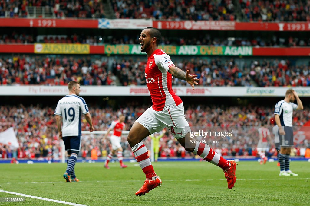 Theo Walcott of Arsenal celebrates scoring his team's second goal during the Barclays Premier League match between Arsenal and West Bromwich Albion at Emirates Stadium on May 24, 2015 in London, England.
