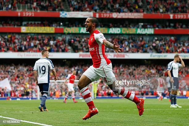 Theo Walcott of Arsenal celebrates scoring his team's second goal during the Barclays Premier League match between Arsenal and West Bromwich Albion...