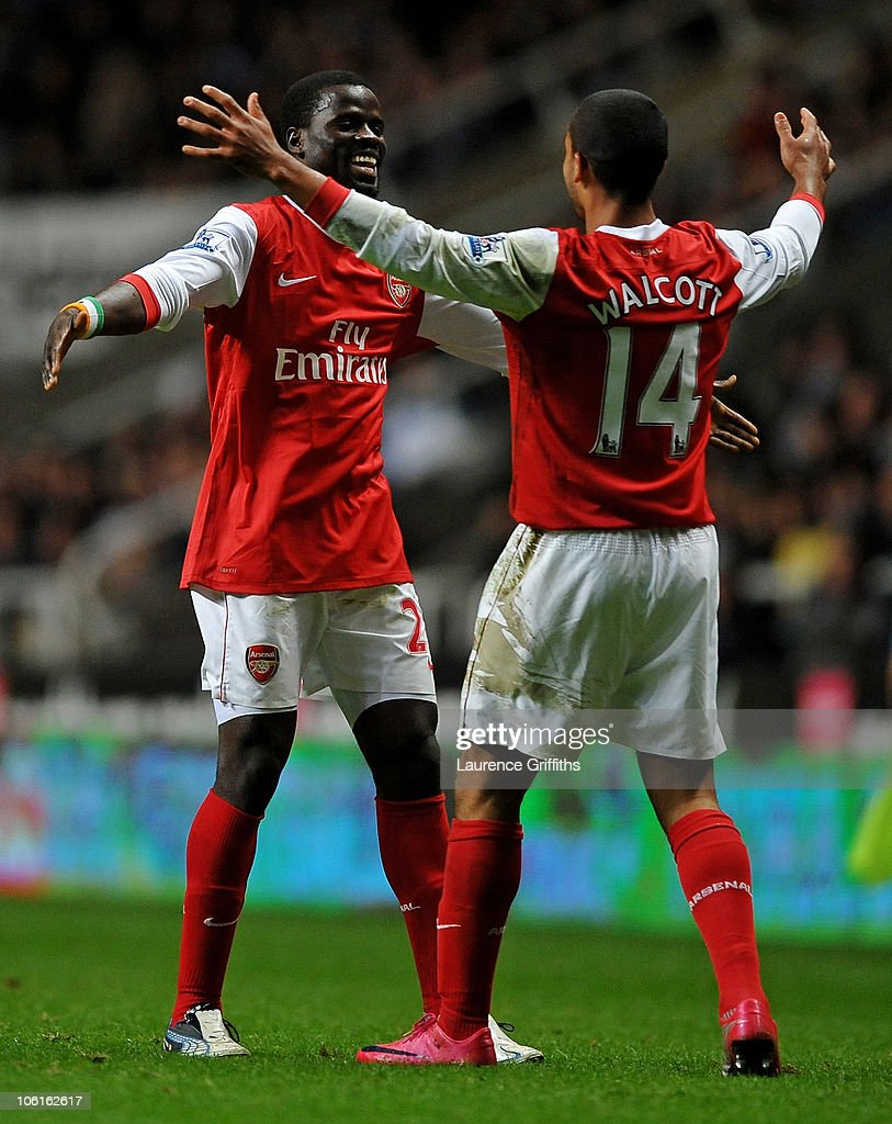 Theo Walcott of Arsenal celebrates scoring his team's second goal with team mate Emmanuel Eboue during the Carling Cup Fourth Round match between Newcastle United and Arsenal at St James' Park on October 27, 2010 in Newcastle, England.