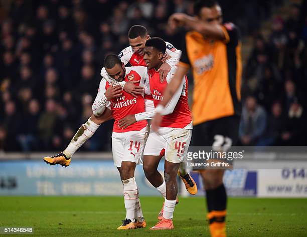 Theo Walcott of Arsenal celebrates scoring his team's third goal with Kieran Gibbs and Alex Iwobi during the Emirates FA Cup Fifth Round Replay match...