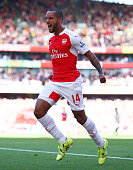 Theo Walcott of Arsenal celebrates scoring the opening goal during the Barclays Premier League match between Arsenal and Stoke City at the Emirates...