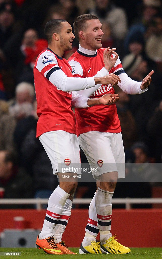 <a gi-track='captionPersonalityLinkClicked' href=/galleries/search?phrase=Theo+Walcott&family=editorial&specificpeople=451535 ng-click='$event.stopPropagation()'>Theo Walcott</a> of Arsenal celebrates scoring their fourth goal with <a gi-track='captionPersonalityLinkClicked' href=/galleries/search?phrase=Lukas+Podolski&family=editorial&specificpeople=204460 ng-click='$event.stopPropagation()'>Lukas Podolski</a> of Arsenal during the Barclays Premier League match between Arsenal and West Ham United at Emirates Stadium on January 23, 2013 in London, England.