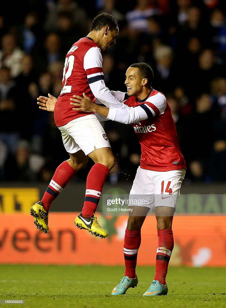 Theo Walcott of Arsenal celebrates with Francis Coquelin after scoring their fourth goal during the Capital One Cup Fourth Round match between Reading and Arsenal at Madejski Stadium on October 30, 2012 in Reading, England.