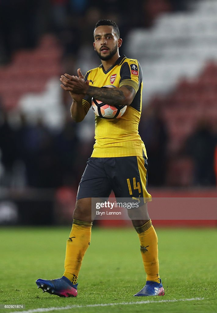 Theo Walcott of Arsenal celebrates with his hat-trick ball after the Emirates FA Cup Fourth Round match between Southampton and Arsenal at St Mary's Stadium on January 28, 2017 in Southampton, England.