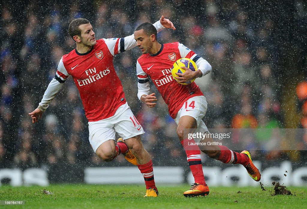 Theo Walcott of Arsenal (14) celebrates with Jack Wilshere of Arsenal as he scores their first goal during the Barclays Premier League match between Chelsea and Arsenal at Stamford Bridge on January 20, 2013 in London, England.
