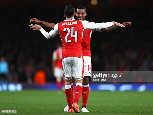 Theo Walcott of Arsenal celebrates with team mate Hector Bellerin during the UEFA Champions League group A match between Arsenal FC and PFC...