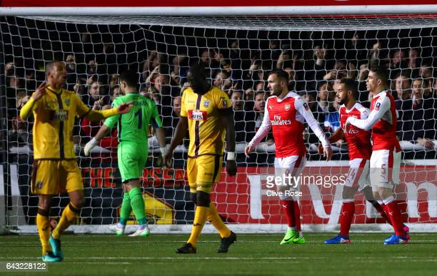 Theo Walcott of Arsenal celebrates with teammates after scoring his team's second goal and his 100th for the club during the Emirates FA Cup fifth...