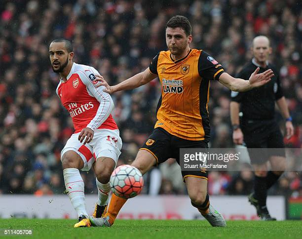 Theo Walcott of Arsenal challenged by Alex Bruce of Hull during the Emirates FA Cup Fifth Round match between Arsenal and Hull City at Emirates...