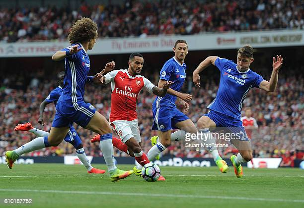 Theo Walcott of Arsenal challenged by David Luiz and Gary Cahill of Chelsea during the Premier League match between Arsenal and Chelsea at Emirates...