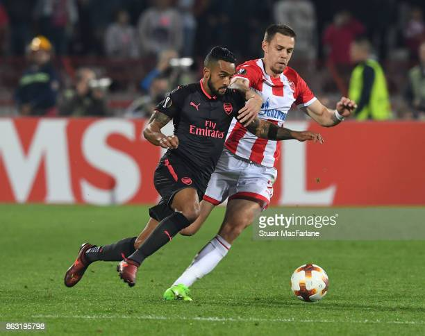 Theo Walcott of Arsenal challenged by Milan Rodic of Red Star during the UEFA Europa League group H match between Crvena Zvezda and Arsenal FC at...