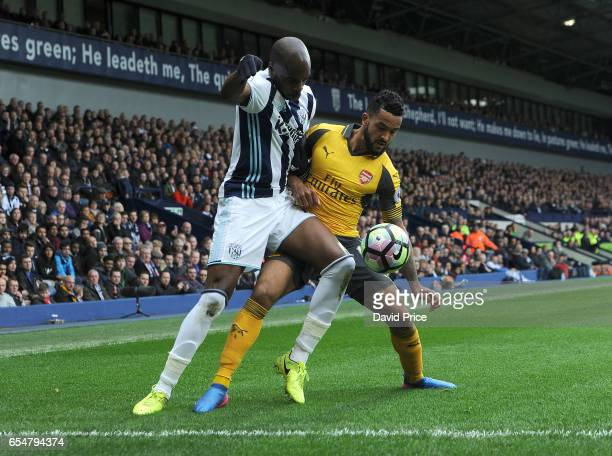 Theo Walcott of Arsenal challenges Allan Nyom of WBA during the Premier League match between West Bromwich Albion and Arsenal at The Hawthorns on...