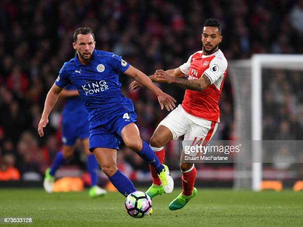 Theo Walcott of Arsenal challenges by Danny Drinkeater of Leicester during the Premier League match between Arsenal and Leicester City at Emirates...