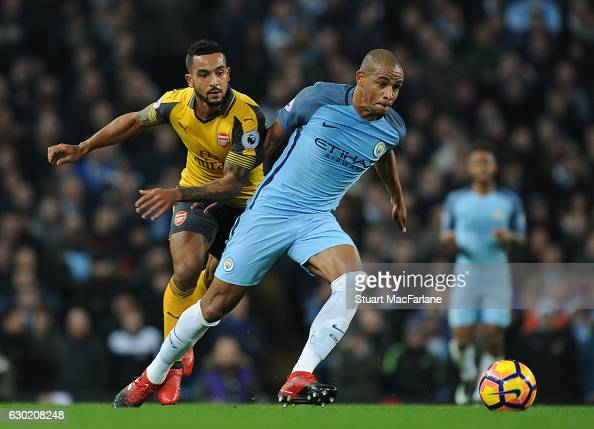 http://media.gettyimages.com/photos/theo-walcott-of-arsenal-challenges-fernando-of-man-city-during-the-picture-id630208248?s=594x594
