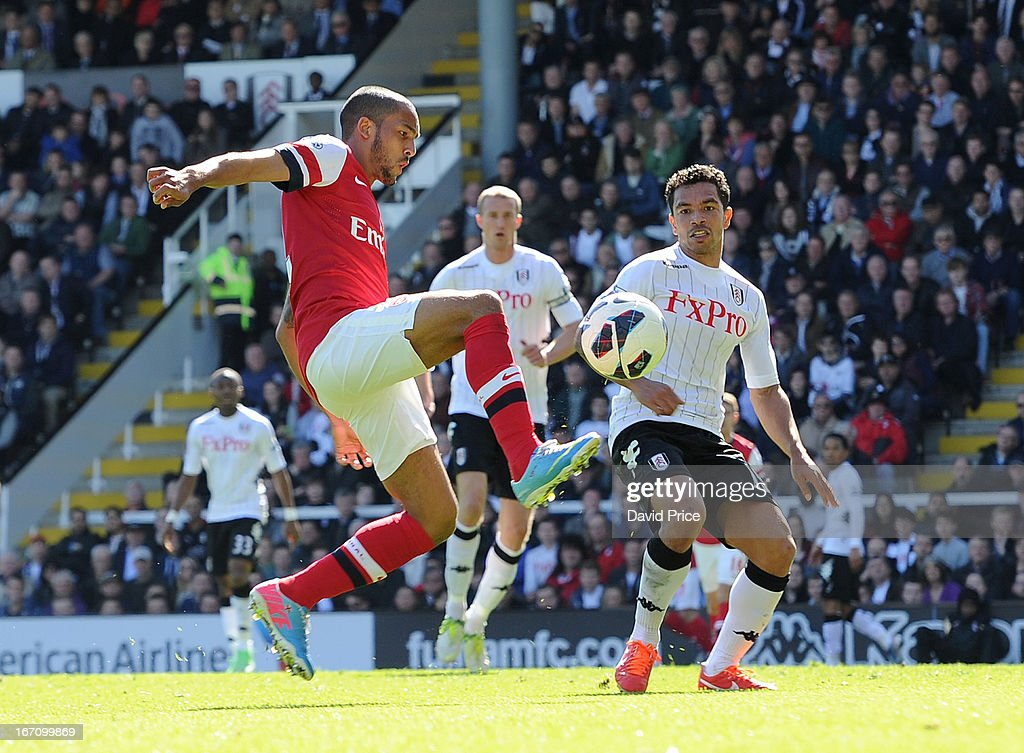 <a gi-track='captionPersonalityLinkClicked' href=/galleries/search?phrase=Theo+Walcott&family=editorial&specificpeople=451535 ng-click='$event.stopPropagation()'>Theo Walcott</a> of Arsenal controls the ball under pressure from <a gi-track='captionPersonalityLinkClicked' href=/galleries/search?phrase=Kieran+Richardson+-+Soccer+Player&family=editorial&specificpeople=208833 ng-click='$event.stopPropagation()'>Kieran Richardson</a> of Fulham during the Barclays Premier League match between Fulham and Arsenal at Craven Cottage on April 20, 2013 in London, England.