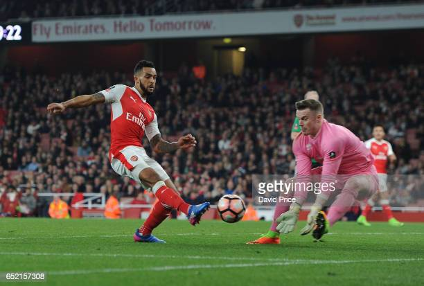 Theo Walcott of Arsenal controls the ball under pressure from Paul Farman of Lincoln during the match between Arsenal and Lincoln City at Emirates...
