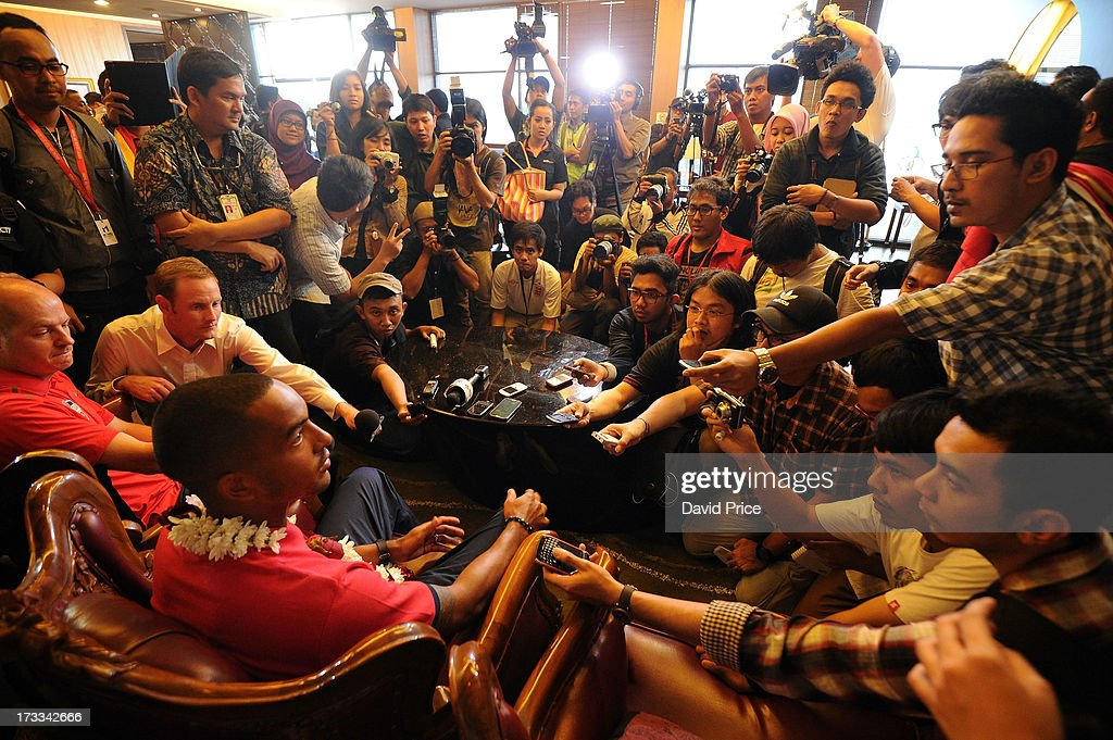 <a gi-track='captionPersonalityLinkClicked' href=/galleries/search?phrase=Theo+Walcott&family=editorial&specificpeople=451535 ng-click='$event.stopPropagation()'>Theo Walcott</a> of Arsenal FC speaks to the press after landing in Indonesia for the club's pre-season Asian tour on July 12, 2013 in Jakarta, Indonesia.