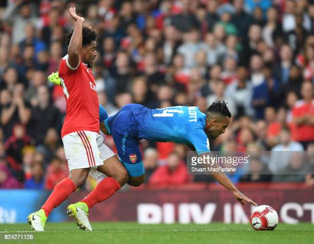 Theo Walcott of Arsenal fouled by Eliseu of Benfica during the Emirates Cup match between Arsenal and SL Benfica at Emirates Stadium on July 29 2017...