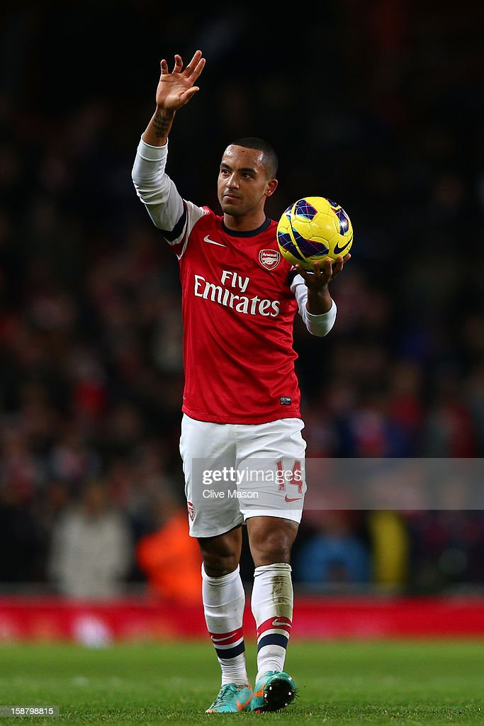 Theo Walcott of Arsenal holds the matchball after scoring a hatrick during the Barclays Premier League match between Arsenal and Newcastle United at the Emirates Stadium on December 29, 2012 in London, England.