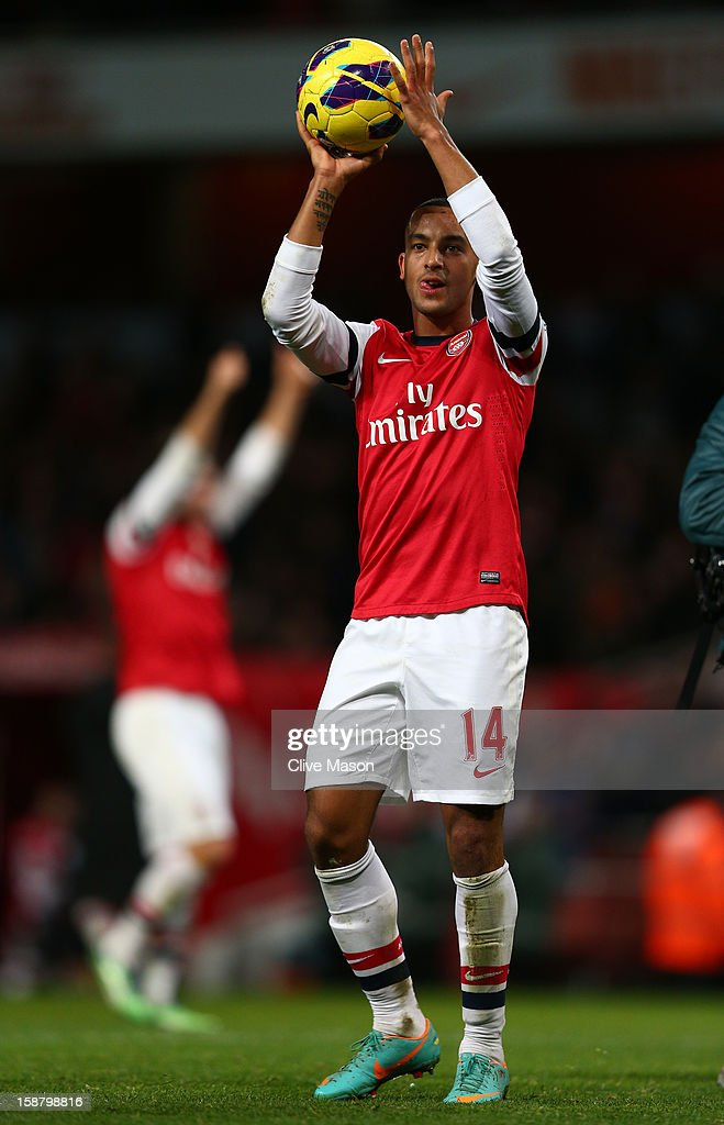 <a gi-track='captionPersonalityLinkClicked' href=/galleries/search?phrase=Theo+Walcott&family=editorial&specificpeople=451535 ng-click='$event.stopPropagation()'>Theo Walcott</a> of Arsenal holds the matchball after scoring a hatrick during the Barclays Premier League match between Arsenal and Newcastle United at the Emirates Stadium on December 29, 2012 in London, England.