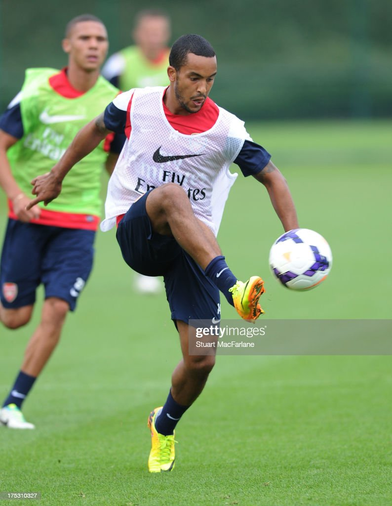 <a gi-track='captionPersonalityLinkClicked' href=/galleries/search?phrase=Theo+Walcott&family=editorial&specificpeople=451535 ng-click='$event.stopPropagation()'>Theo Walcott</a> of Arsenal in action during a training session at London Colney on August 02, 2013 in St Albans, England.