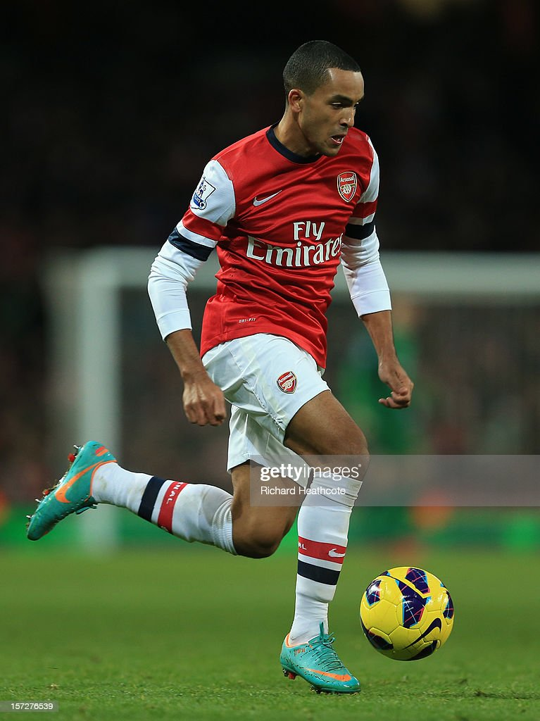 <a gi-track='captionPersonalityLinkClicked' href=/galleries/search?phrase=Theo+Walcott&family=editorial&specificpeople=451535 ng-click='$event.stopPropagation()'>Theo Walcott</a> of Arsenal in action during the Barclays Premier League match between Arsenal and Swansea City at the Emirates Stadium on December 1, 2012 in London, England.