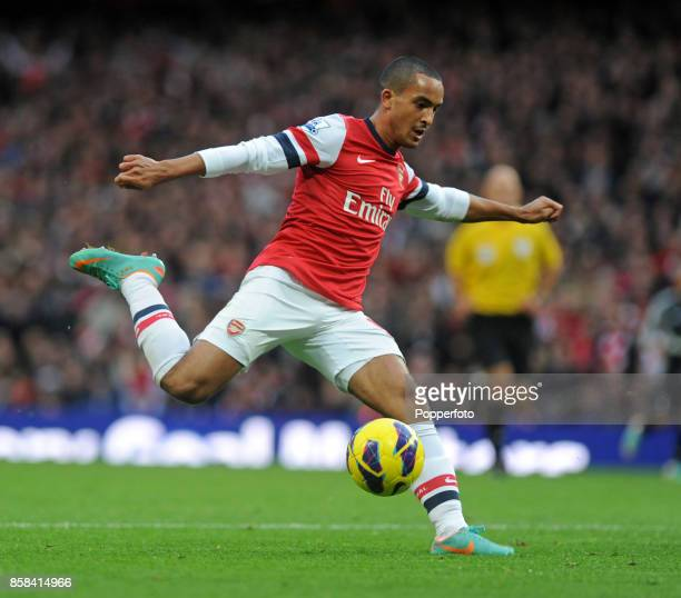 Theo Walcott of Arsenal in action during the Barclays Premier league match between Arsenal and Tottenham Hotspur at the Emirates Stadium on November...