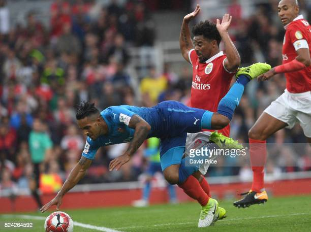 Theo Walcott of Arsenal is challenged by Eliseu of Benfica during the match between Arsenal and SL Benfica at Emirates Stadium on July 29 2017 in...
