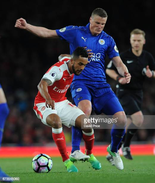 Theo Walcott of Arsenal is closed down by Robert Huth of Leicester during the Premier League match between Arsenal and Leicester City at Emirates...