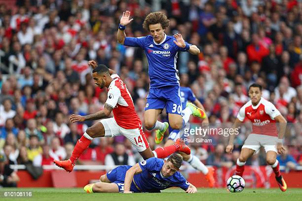 Theo Walcott of Arsenal is fouled by Gary Cahill of Chelsea during the Premier League match between Arsenal and Chelsea at the Emirates Stadium on...