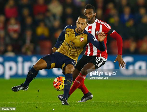 Theo Walcott of Arsenal is watched by Cuco Martina of Southampton during the Barclays Premier League match between Southampton and Arsenal at St...