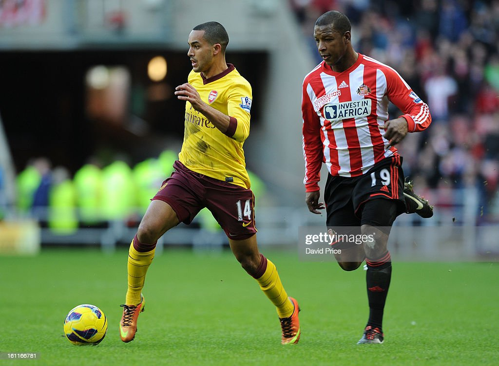 Theo Walcott of Arsenal leaves Titus Bramble of Sunderland in his wake during the Barclays Premier League match between Sunderland and Arsenal at Stadium of Light on February 09, 2013 in Sunderland, England.