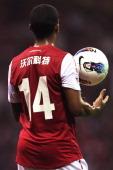 Theo Walcott of Arsenal play the ball during the preseason friendly match between Hangzhou Greentown and Arsenal at Yiwu Meihu Stadium on July 16...