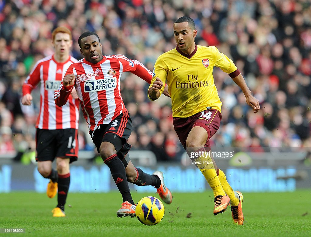 <a gi-track='captionPersonalityLinkClicked' href=/galleries/search?phrase=Theo+Walcott&family=editorial&specificpeople=451535 ng-click='$event.stopPropagation()'>Theo Walcott</a> of Arsenal races past Danny Rose of Sunderland during the Barclays Premier League match between Sunderland and Arsenal at Stadium of Light on February 09, 2013 in Sunderland, England.